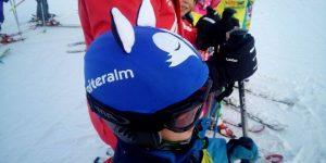 reiteralm-boy-wearing-blue-sleepy-fox-helmet-cover