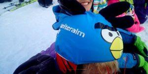 reiteralm-student-wearing-blue-bird-helmet-cover
