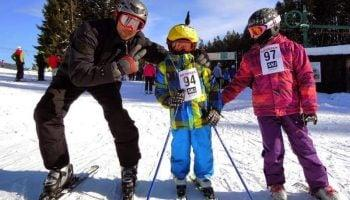family-skiing-in-custom-helmet-covers