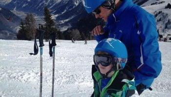 father-and-son-skiing-in-custom-helmet-covers