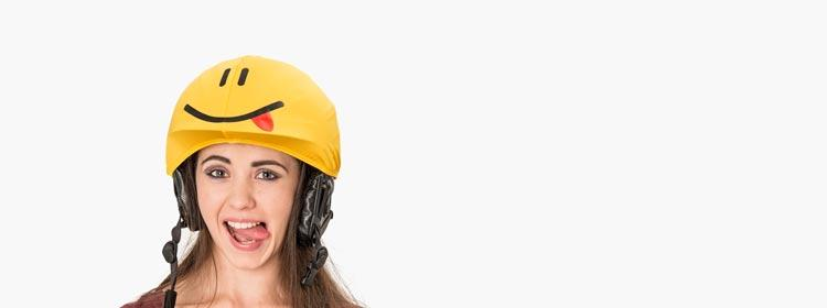 yellow smiley helmet cover tongue girl